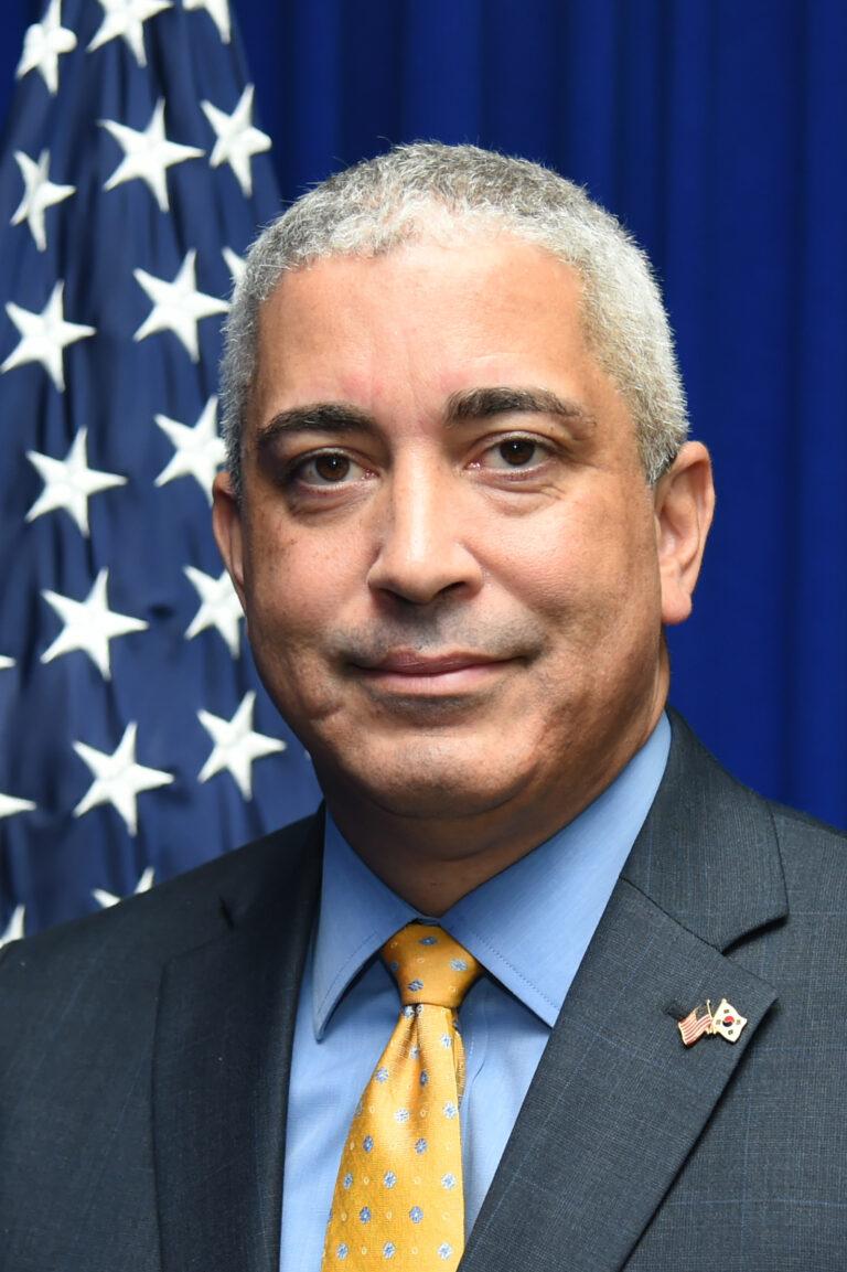 Photo of Chargé d'Affaires ad interim Christopher Del Corso