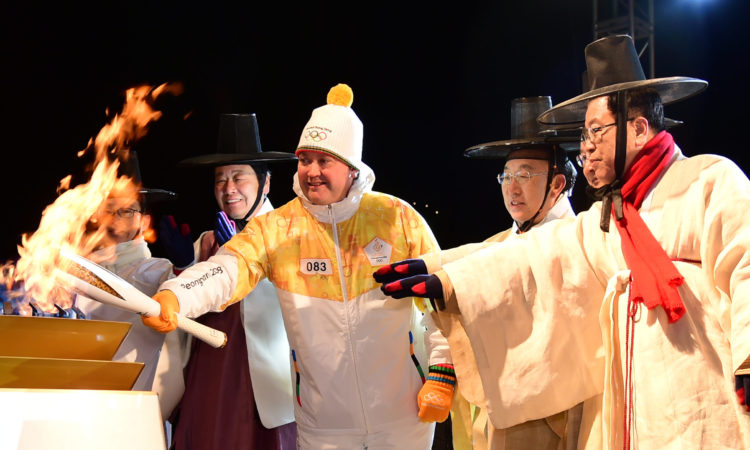 December 26, 2017 - Chargé d'Affaires Marc Knapper and his son Alex carried the Olympic flame through renowned UNESCO World Heritage site Hahoe Village as part of the Andong portion of the relay.