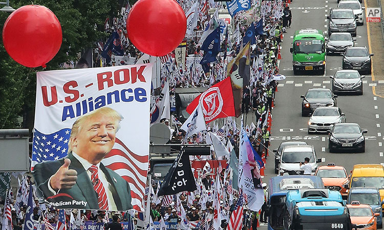 June 29, 2019 - South Koreans march after a rally to welcome the U.S. President Donald Trump in Seoul, South Korea. (AP Photo)