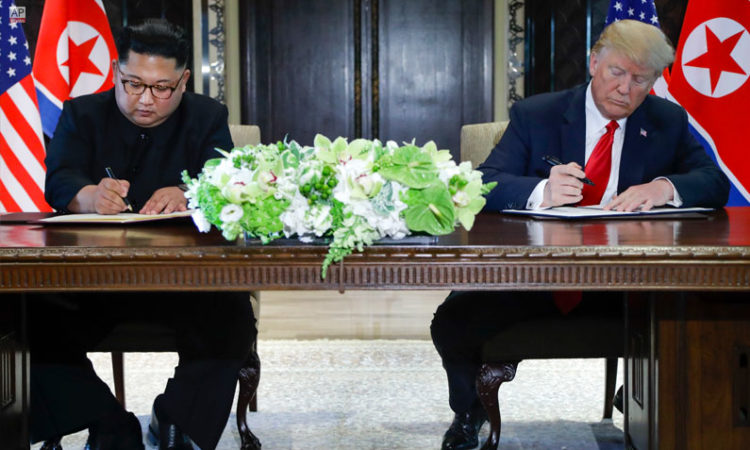June 12, 2018 - U.S. President Donald Trump and North Korean Chairman Kim Jong Un signed documents after their meetings at the Capella Hotel in Singapore. (AP Photo)