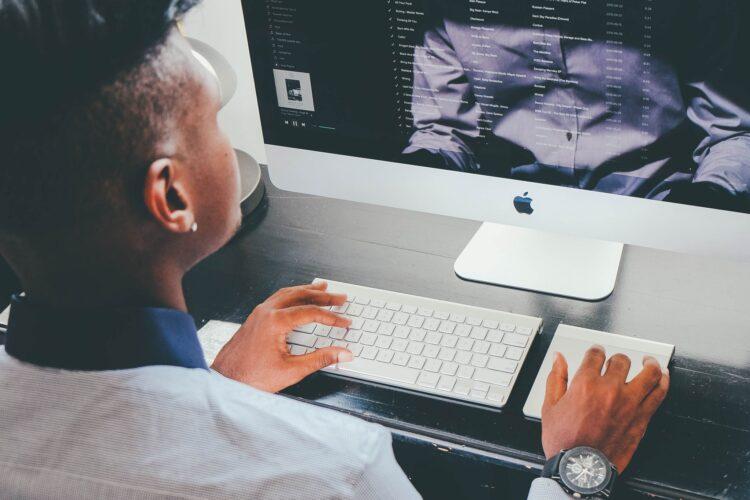 Woman working at iMac