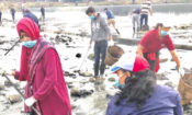 Access Alumni from the Summit help remove trash from the Bagmati River in Kathmandu