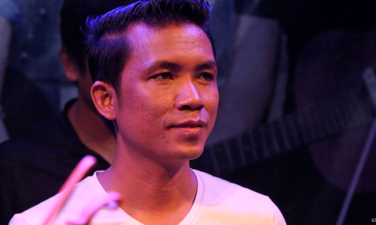 Cambodian singer/songwriter Yong Yorn at a concert in Battambong [U.S. Embassy photo by Un Yarat]