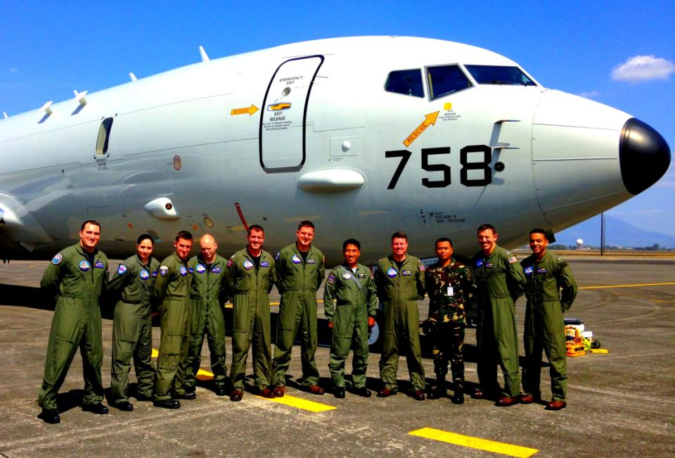 1st. Lt. Paat, Philippines Air Force (3rd person from right) and Lt. j.g. Arquillo Filipino Navy (5th from right) , pose with aircrew members of Combat Air Crew Four and a P-8A Poseidon assigned to Patrol Squadron 45 following a bilateral patrol mission. Patrol Squadron 45 is currently on detachment to the Philippines Clark Air Base in support of the 7th Fleet Commander's objectives aimed at strengthening maritime partnerships in the Pacific Region (U.S. Navy photo)