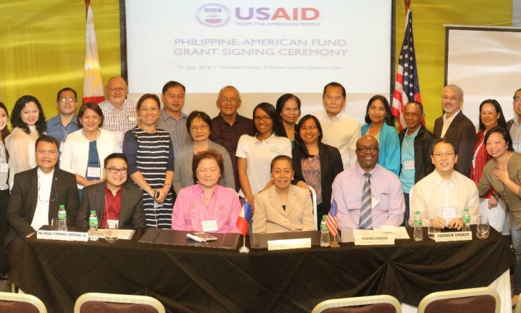 United States Agency for International Development (USAID), through the Philippine–American Fund (Phil-Am Fund), signed grants with seven local organizations to help combat human trafficking, as well as to support biodiversity programs. Present at the grant signing were USAID Director for Office of Economic Development and Governance Stephen Andoseh (seated 2nd from right) and President of Gerry Roxas Foundation Ms. Judy Araneta- Roxas (seated, 3rd from right). Also present were USAID Officers and key officials from partner organizations Phil-Am Fund and Gerry Roxas Foundation.