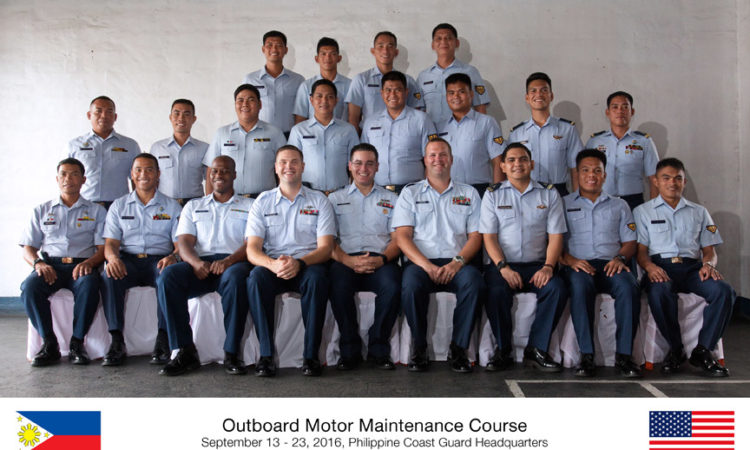 USCG and PCG personnel take time out of their training schedule for a group photo, Philippine Coast Guard Headquarters, Manila.