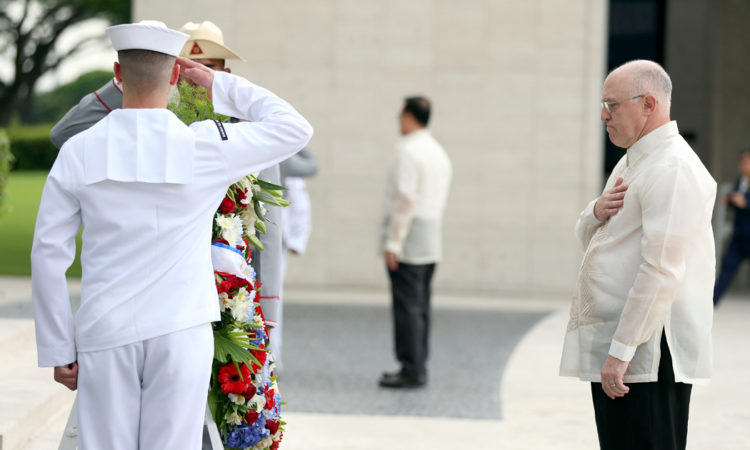 Chargé d'Affaires Michael S. Klecheski observes a moment of silence during the wreath laying portion of the Veterans Day ceremony, November 11, 2016, Manila American Cemetery, Taguig City.