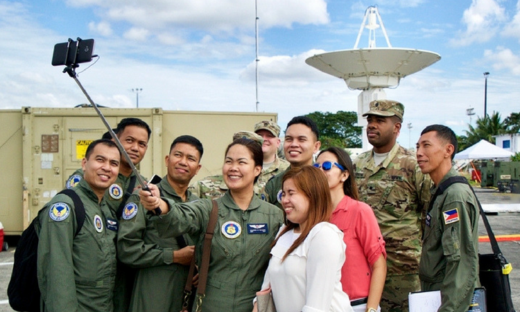 A group of Philippine Air Force members and U.S. Soldiers crowd together to take a selfie after training together at Clark Air Base as part of a U.S. bilateral training exercise to promote enhanced security cooperation and increased disaster response capabilities.