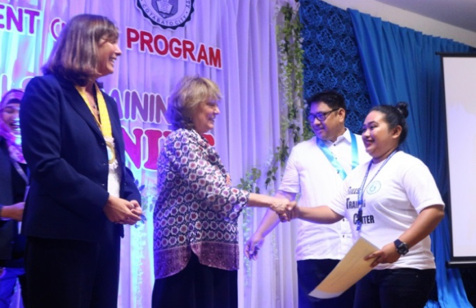 USAID Mission Director Dr. Susan Brems, alongside Nancy Wallace, Chief of Party for USAID's Mindanao Youth for Development activity, and Father Charlie Inzon, President of Notre Dame University, led the graduation and handed out certificates of completion to the graduates.
