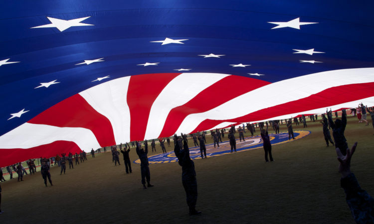 People under American flag