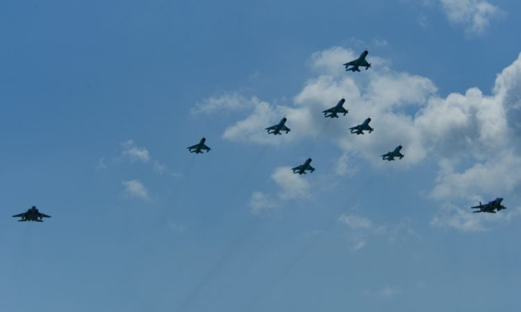 A flight formation of Romanian air force MiG-21 LanceR aircraft and U.S. Air Force F-15C Eagle fighter aircraft fly during the RoAF's 71st Air Base's air show and open house at Campia Turzii, Romania, July 23, 2016.