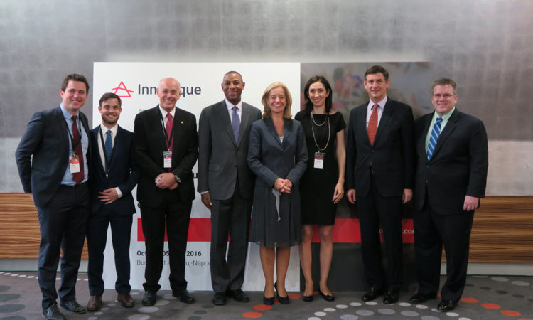 Charge d'Affaires Dean Thompson, right, and participants at the Innoteque Conference