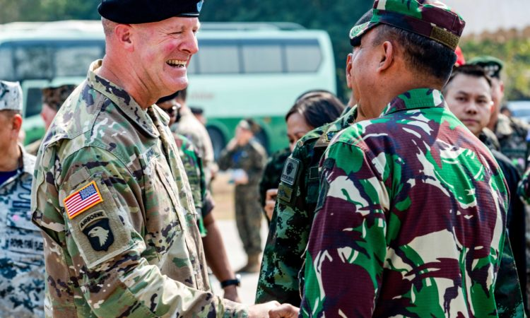 U.S. Army Maj. Gen. Pete Johnson, U.S. Army Pacific deputy commander representing U.S. Indo-Pacific Command, shakes hands with an Indonesian soldier during the opening ceremony of exercise Cobra Gold 2020 (U.S. Navy photo by Mass Communication Specialist 1st Class Julio Rivera)