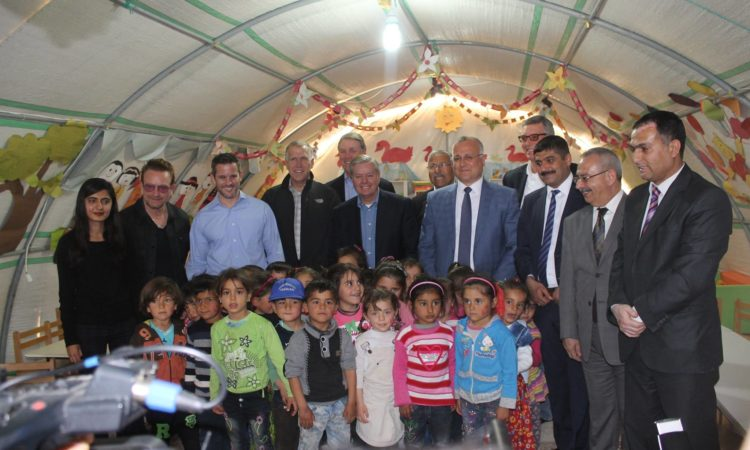 Senator Graham and other Senators and Congress Members, as well as Bono with Syrian Children in Tent Camp
