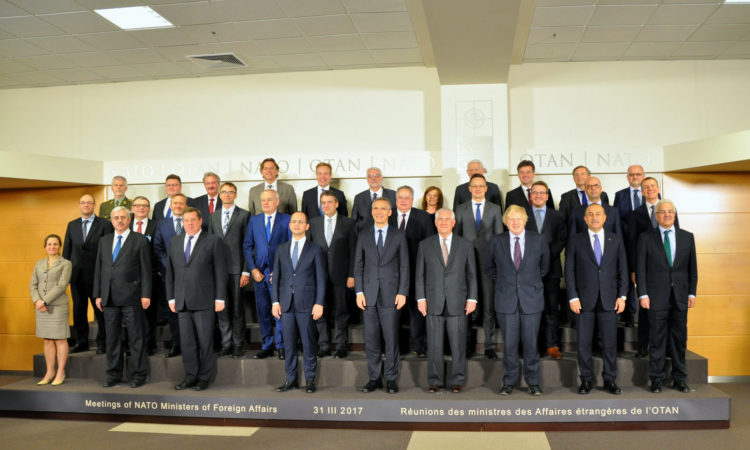 U.S. Secretary of State Rex Tillerson stands with NATO colleagues for family photo at the NATO Foreign Ministerial in Brussels, Belgium, on March 31, 2017. [State Department photo/ Public Domain]