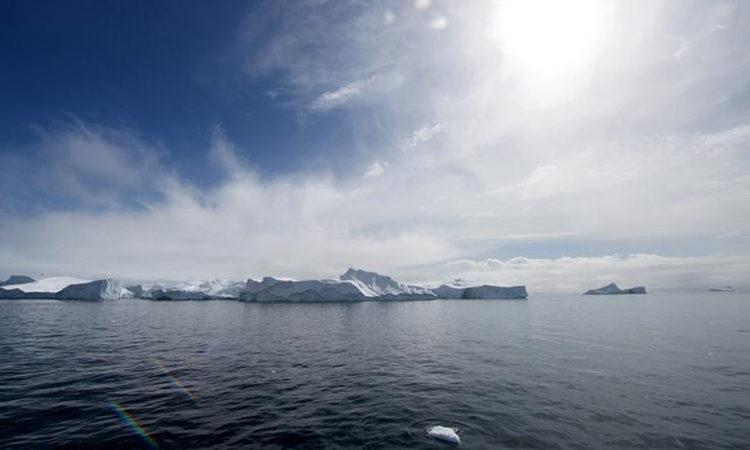 Icebergs float off the port of Ilulissat, Greenland. June 17, 2016.