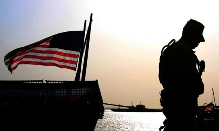 American flag flying half mast. © AP Image A Day of Remembrance