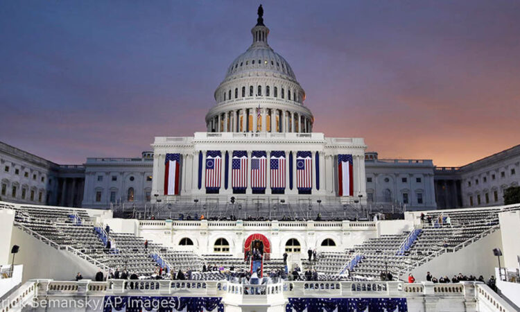 Dawn breaks behind the Capitol in Washington on Inauguration Day in 2017. (© Patrick Semansky/AP Images)